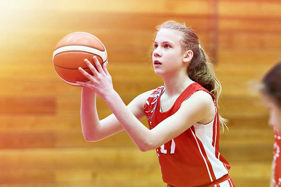 Girl Concentrating on a Basketball Shot